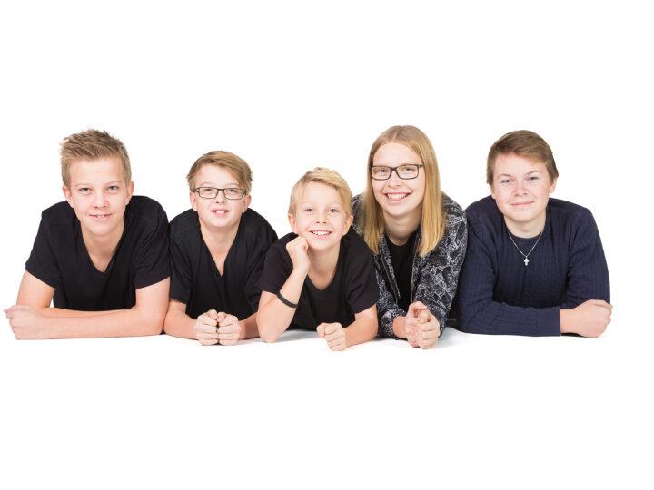 Familjefotografering med sportig ton